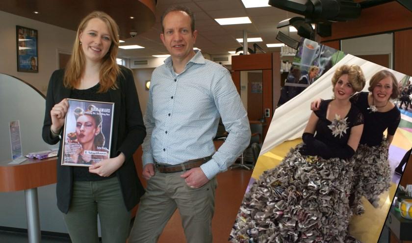 Emma Schapelhouman samen met haar stagebegeleider Marco Leus. Inzet: De winnende creatie met een hoed van haar en een jurk van kranten.