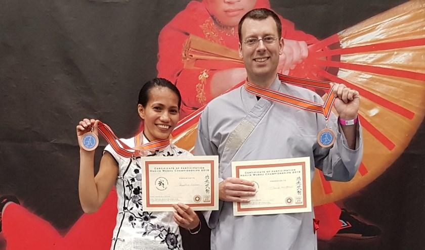 Argentina Cotcheza en Douwe ter Horst met hun bronzen medailles