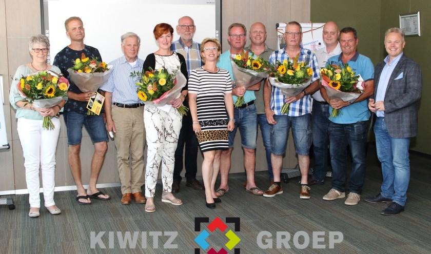 De jubilarissen samen met de directie Kiwitz Groep BV