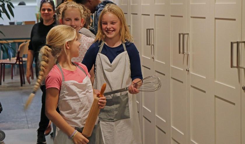 Koken maakt mensen blij. Foto: Marja van Eijk.