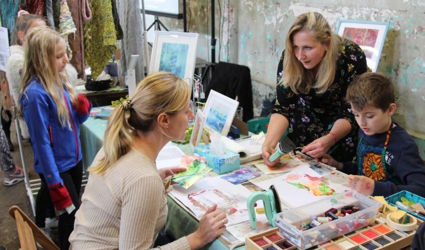 Bezoekers konden mee doen met workshops en gezellig rondneuzen tussen de kraampjes.