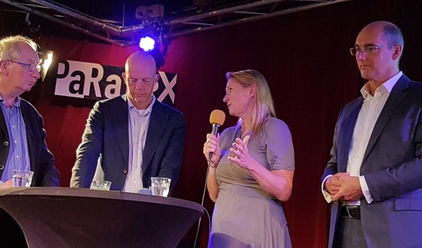 Milieucafé-redacteuren Marc Pruijn en Frans Post in gesprek met Maya van der Steenhoven en Oscar Dusschooten over de energietransitie in Tilburg.