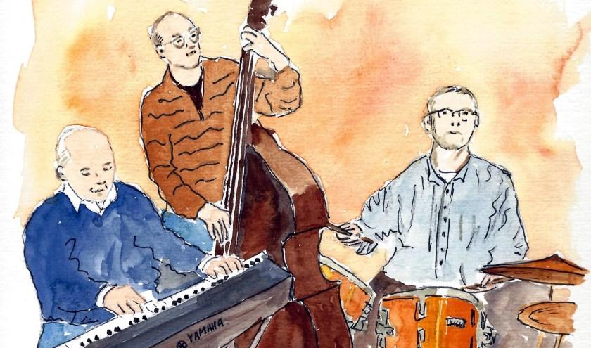 Het Bentinck jazz trio zorgt voor extra sfeer tijdens het gratis diner in de Bonte Koe