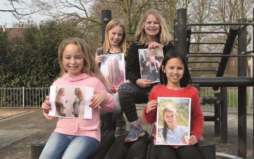 Vlnr: Larissa Stoks, Linn Punselie, Romy Berendsen en Danae Swart. De knipactie vond plaats eind vorig jaar. Te zien is dat de haren van de jongedames inmiddels alweer flink zijn aangegroeid.