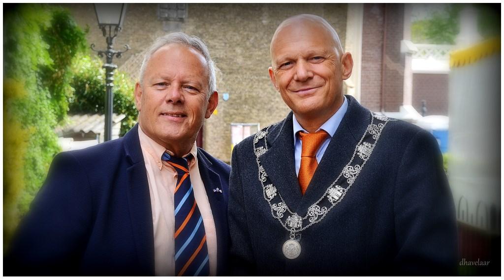 Koningsdag 2019, laatste werkdag. Met de Rotterdamse wethouder en loco-burgemeester Bert Wijbenga. (Foto: Danny Havelaar) Foto: Picasa © DPG Media