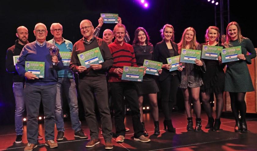 De winnaars in de categorie Sportploeg en Coach van het jaar. Foto: John de Pater