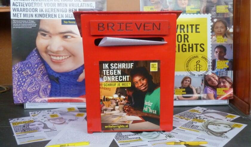 <p>Schrijf mee en zorg ervoor dat onschuldigen uit de gevangenis komen. Foto: Amnesty-groep Boskoop&nbsp;</p>