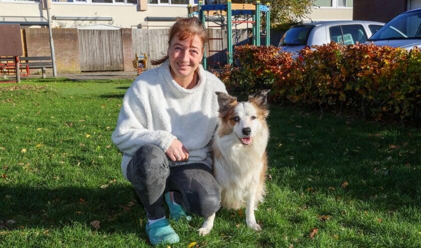 <p>Esther Dickhoff met haar hond Sneaky, een prachtige sable merle Bordercollie. FOTO: Bert Jansen. </p>