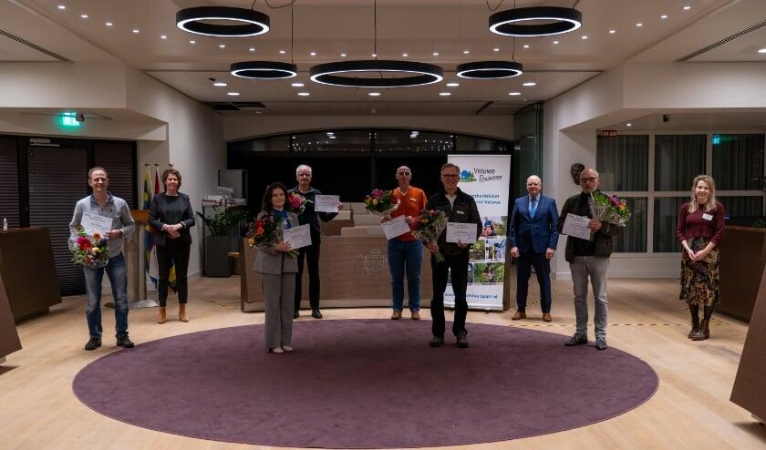<p>Zes energiecoaches (1 coach staat niet op de foto), de wethouder en twee medewerkers van Veluwe Duurzaam.</p>