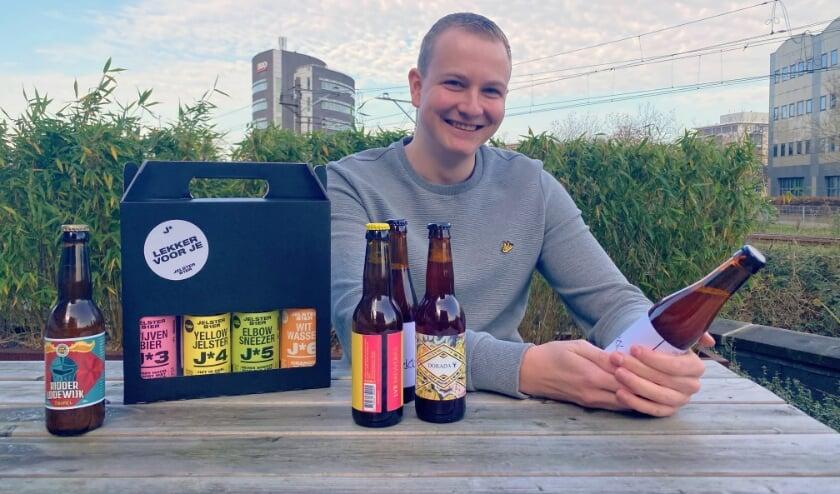 <p>John Wesselman (26) is bedenker van Bier Online, hij runt de bierwebshop samen met Maarten Blonk. FOTO: Rens van der Meer</p>