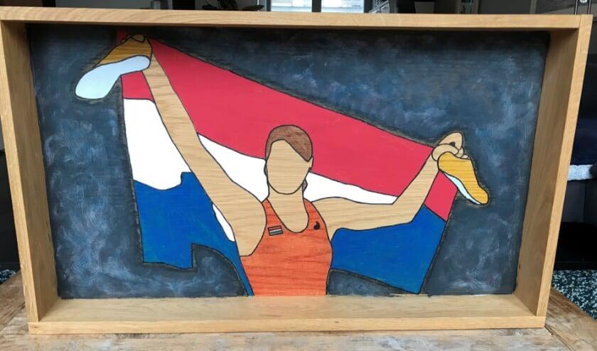<p>Een van de wandobjecten: Dafne Schippers op la, gemaakt van een oude salontafel.</p><p>&nbsp;</p>