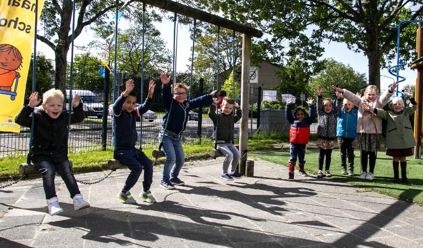 Kinderen van de Toermalijn in Zwijndrecht zijn blij weer naar school te kunnen.