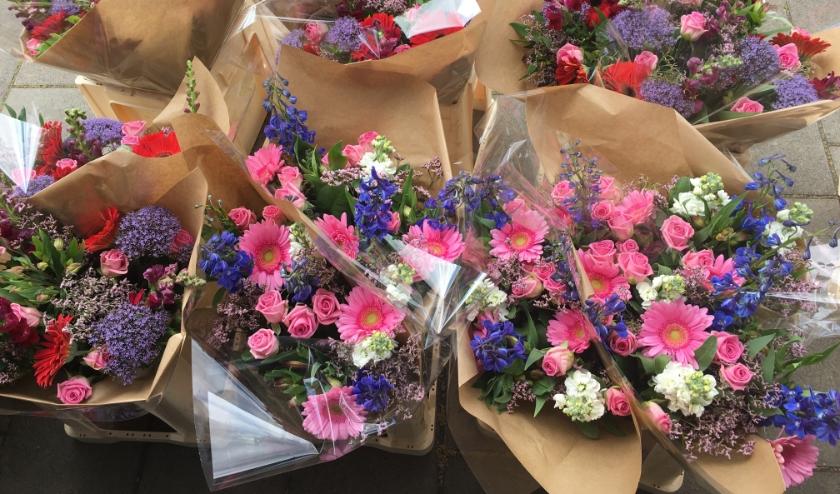 Een honderdtal HEVO-leden kreeg daarom afgelopen week een bloemetje.