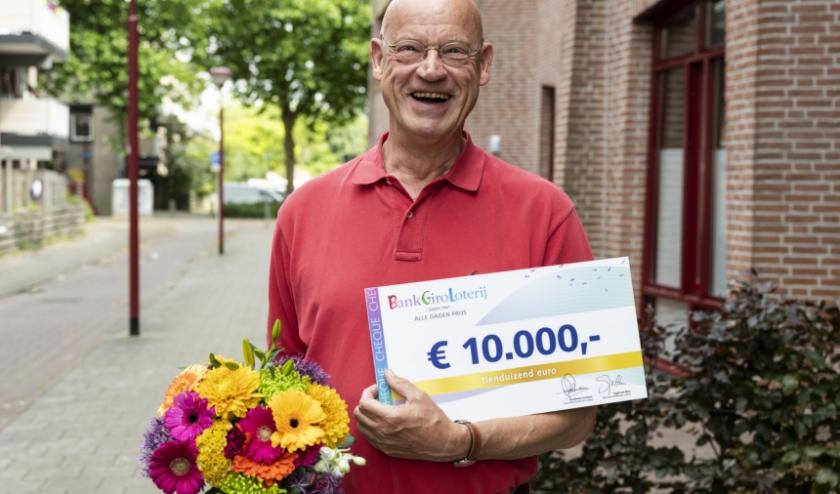Karel uit Nieuwegein wint 10.000 euro in BankGiro Loterij. Foto: Jurgen Jacob Lodder