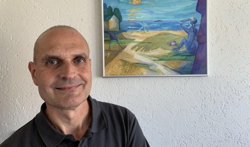 Woordkunstenaar Hans Lambrechts bij de door Dick Baauw geschilderde impressie van één van Hans' gedichten.