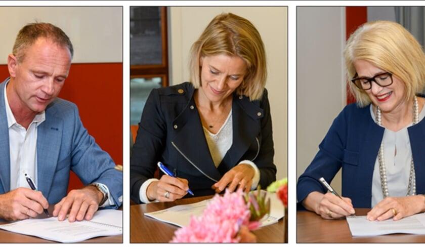 Ondertekening van de intentieovereenkomst door Job van Zomeren (directeur ERA Contour namens OCNK), Lonneke Zuijdwijk (directeur Heijmans Vastgoed namens OCNK) en Maria Molenaar (voorzitter Raad van Bestuur Woonstad Rotterdam)