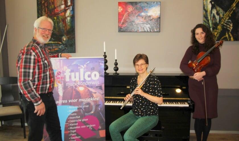 <p>Han Theil, Astrid Dam en Lisa Eggen kijken uit naar samenspelen met alle docenten en (200) leerlingen van FMO.</p>