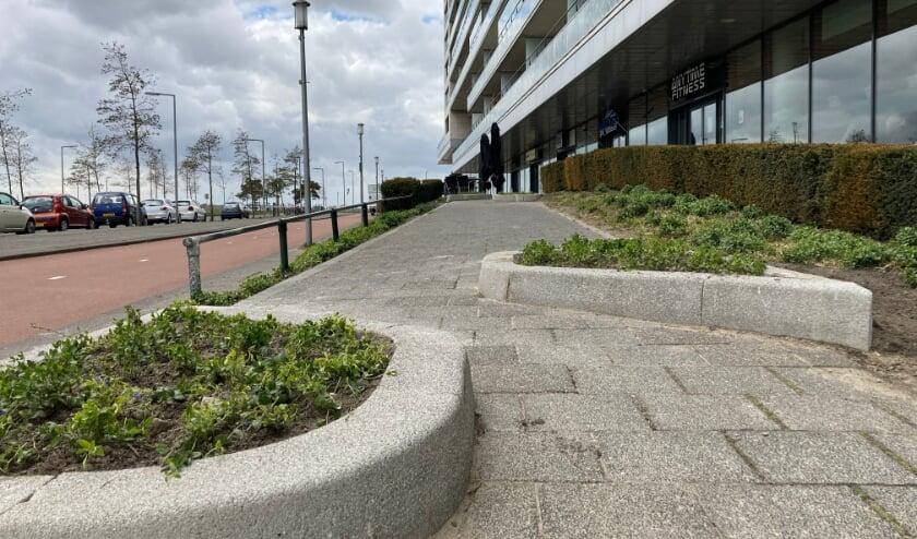 Plantenbakken om fietsers te weren