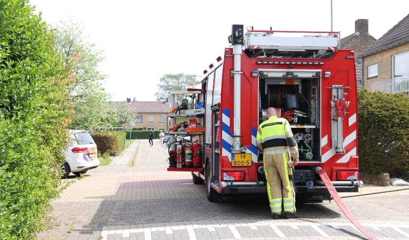 Brandweer blust containerbrandje